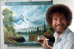 Bob Ross with a completed painting