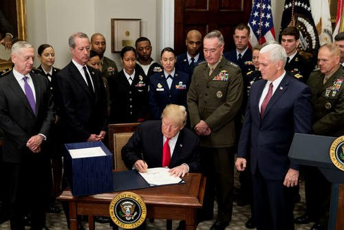 President Trump signs the National Defense Authorization Act for fiscal year 2018, in the Roosevelt Room at the White House on Dec. 12. (White House photo/Stephanie Chasez)