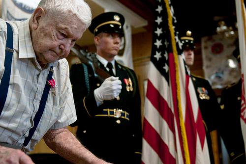 Martin L. Paulson, a World War II veteran, stands by the I Corps Honor Guard during an award ceremony in Westport, Wash., Aug. 30, 2013. (U.S. Army/Staff Sgt. Miriam Espinoza Torres)