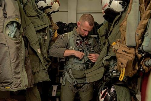 A pilot prepares for flight on board USS Ronald Reagan (CVN 76). (Kenneth Abbate/U.S. Navy)