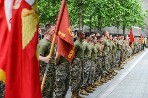 Marines, Sailors, and Coast Guardsmen stand in formation following the 2017 Freedom Run at the 9/11 Memorial Plaza in New York, May 28, 2017. Service members participated in the run to honor the lives lost in the 9/11 terrorist attacks. (U.S. Marine Corps photo/Troy Saunders)