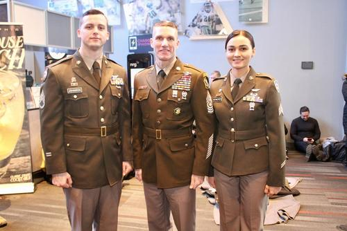 Sergeant Major of the Army Dan Dailey stands with Soldier models wearing the proposed Pink & Green daily service uniform at the Army-Navy game in Philadelphia, Pennsylvania December 9, 2017. (US Army photo by Ron Lee)