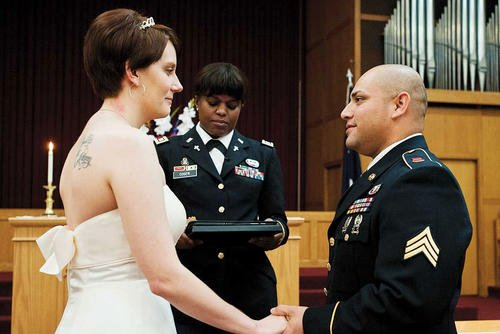 Sgt. Victor Arias, 725th Brigade Support Battalion transportation technician, and Sara, his wife, renew their wedding vows at the Soldier's Chapel on Joint Base Elmendorf-Richardson in 2011. (U.S. Air Force/Zachary Wolf)