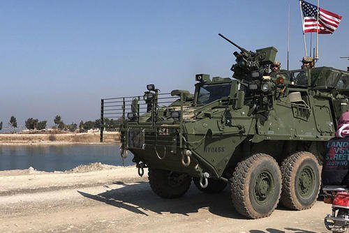 FILE PHOTO -- Photos of Strykers and up-armored Humvees flying U.S. flags were posted on social media after the U.S. regional command confirmed that Special Forces troops in northeastern Syria had moved toward Manbij. Photo via Twitter
